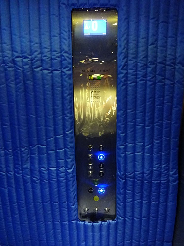 Blue drapes showing access panel